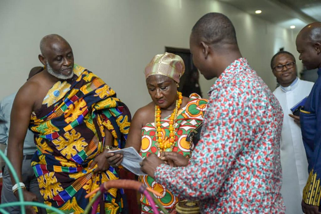 Adam Dokurugu (right) of BNGh explaining a point to the Osu Kinkawe Dzaatsenye, Naa Teinor Osaayilo I (middle), and the Osu Mantse, Nii Okwei Kinka Dowuona IV, on the side lines of the forum